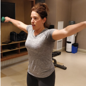 Picture of Catherine Doing Lateral raises during in home training session